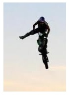 FMX moves on a dirt bike