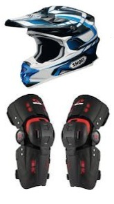 dirtbike helmet and knee braces ready