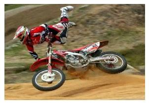 having a dirt bike crash on a track