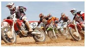 racing on dirtbike tracks