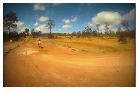 riding a motocross track on a dirtbike