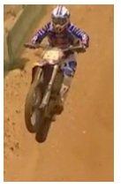 dirt biker motocross racing on a track