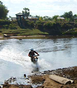 dna dirt bike rider in the river