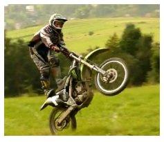 motocross dirtbike wheelie on a motorbike