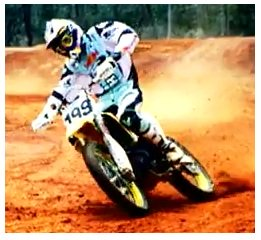 picture of a dirtbike rider on a corner
